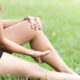 Leg Pain In A Woman on green background