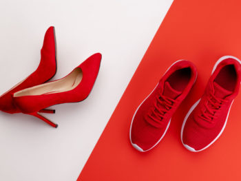 A studio shot of pair of running vs high heel shoes on color background, sport relax after office work concept. Flat lay.